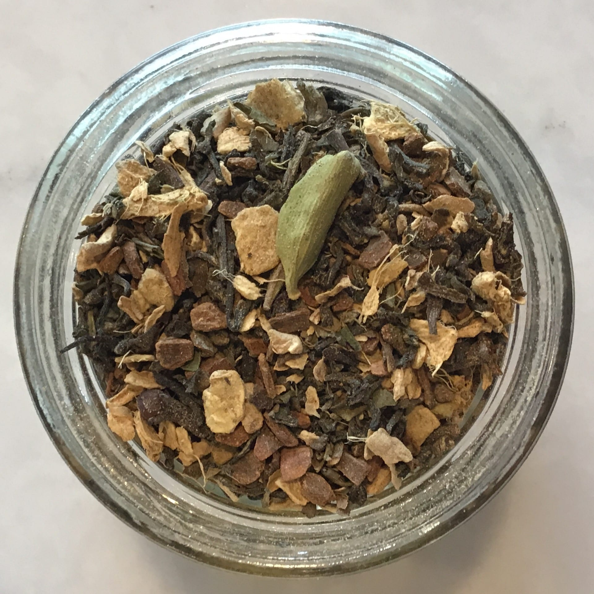 Enjoy this delicious organic caffeinated chai tea blend - warming spices with organic darjeeling black tea